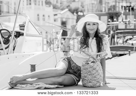 Happy beautiful young girl barefoot on a mooring in the summer ( black and white )