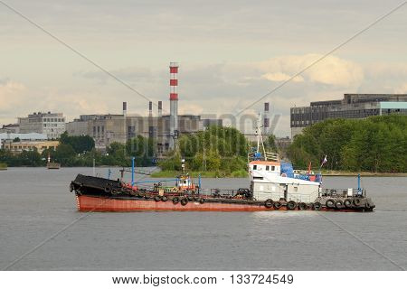 Russia.Saint-Petersburg.Port on Kanonersky island.The picture shows a tug working in the port.