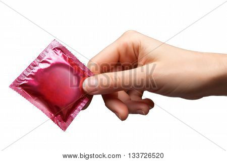 Condom in female hand isolated on white background