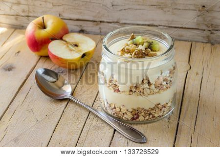 Breakfast with muslie. Healthy breakfast concept with oat flakes,walnuts  and fresh fruits  on wooden rustic background.