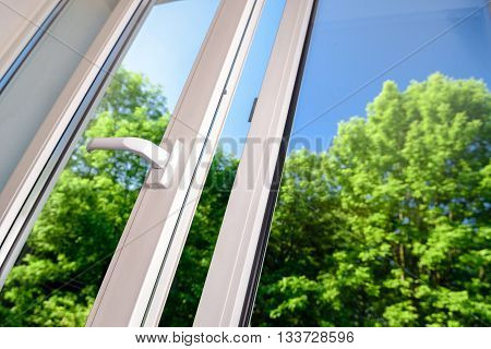 open plastic vinyl window on a background blue sky