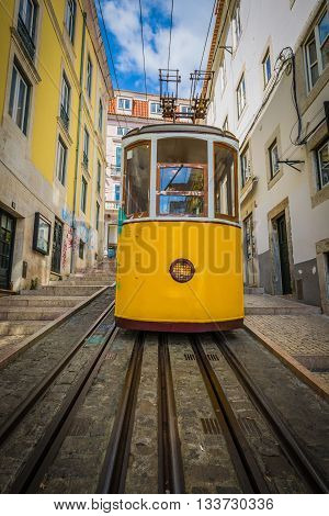 Romantic yellow tramway - main symbol of Lisbon Portugal
