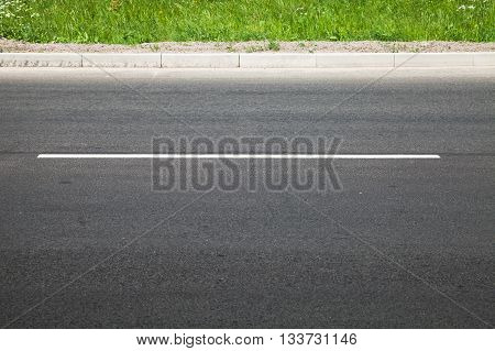 Empty Highway With Dividing Line And Roadside