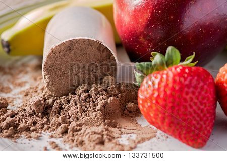 Close up of meal replacement or protein powder with strawberries