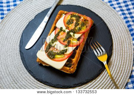 Belgian Waffle With Sauce, Melted Cheese And Tomatoes With Herbs