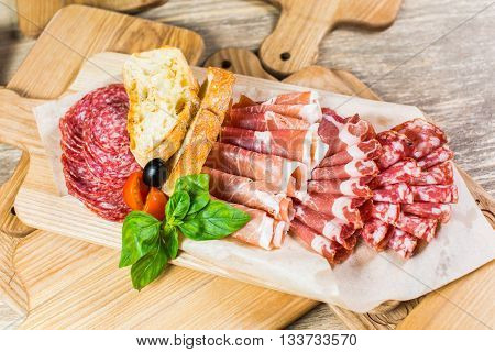 Delicious And Tasty Meat Dishes. Ham, Salami, Prosciutto. Italian Appetizers.