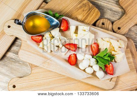 Delicious Cheese Heaven. Cheese Mix, Gouda Cheese, Cheese Parmesan, Feta Cheese And Strawberries Wit
