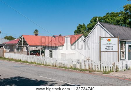 KNYSNA SOUTH AFRICA - MARCH 3 2016: The Knysna Museum Complex comprises historic timber and corrugated iron buildings including Millwood House Parkes Shop Pitt Street House and Parkes Cottage