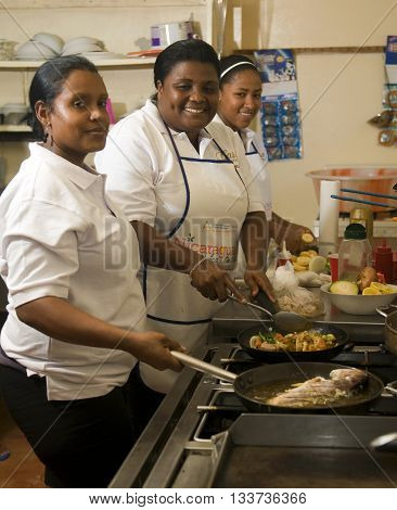 Big Corn Island Nicaragua-April 2: Cooks and kitchen staff are seen cooking fish and vegetables in hotel in Big Corn Island Nicaragua Central America on April 2 2014.