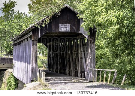 Hillsboro Kentucky USA - May 26 2016: Ringos Mill Covered Bridge built in 1869 spans Fox Creek. One of three covered bridges in Fleming County Kentucky. It was named for a grist mill 50 yards downstream.