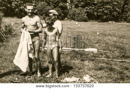 AUGUSTOW, POLAND, CIRCA 1960's: Vintage photo of boys during a canoe trip