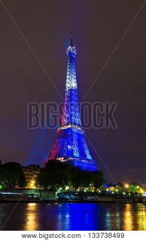paris; France-June 10 2016 : The Eiffel tower lit up in color of French flag for celebrate France victory over Romania in the opening match of soccer championship Euro 2016.