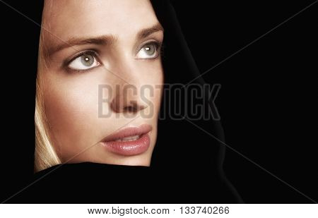 Beautiful woman with Black Robe isolated on Black