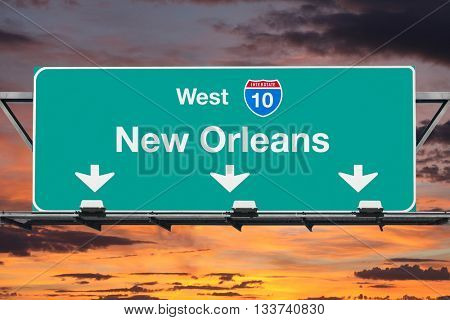 New Orleans Interstate 10 west highway sign with sunrise sky.