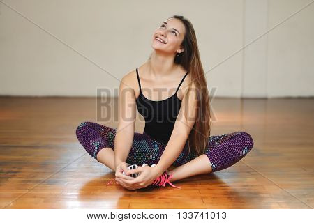 Portrait of an athlete young woman at gym. Indoors.