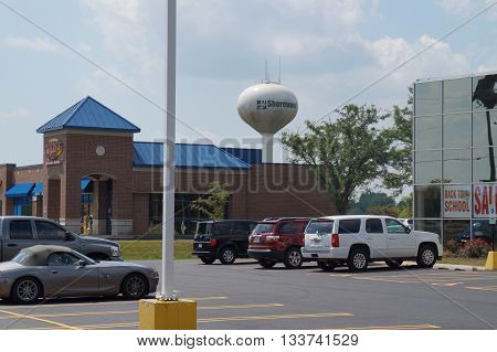 SHOREWOOD, ILLINOIS - AUGUST 16, 2015: The Shorewood water tower stands behind a strip mall in Shorewood.