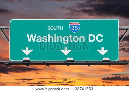 Washington DC Interstate 95 south highway sign with sunrise sky.