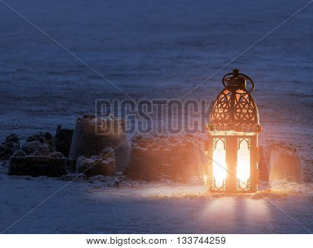 Lantern lighting with candle children play with it in Ramadan night also called ramadan lantern
