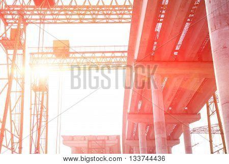 concrete highway under construction against the sun