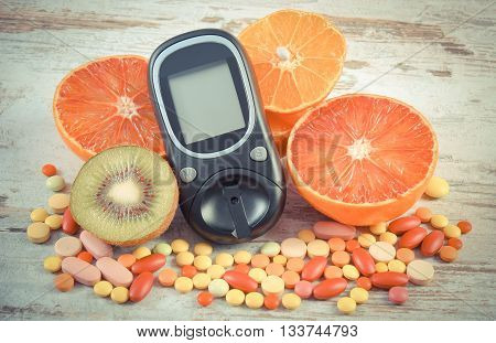 Vintage Photo, Glucometer, Fruits And Colorful Medical Pills, Diabetes, Healthy Lifestyle And Nutrit