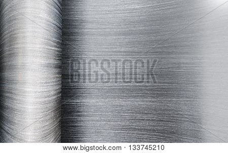 Roll a sheet of stainless steel used background.