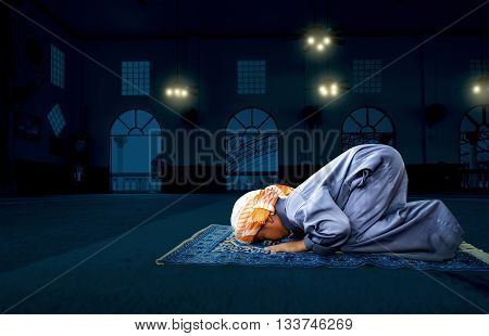 muslim child praying for Allah muslim God on the mosque floor background