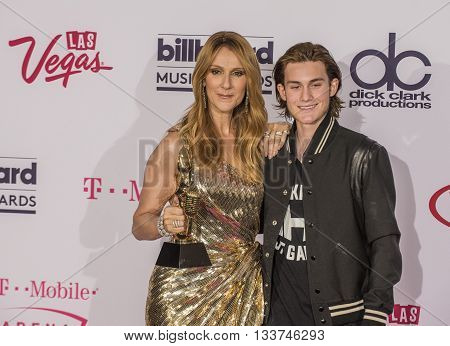 LAS VEGAS - MAY 22 : Honoree Celine Dion recipient of the Icon Award (L) and Rene-Charles Angelil poses in the press room at the 2016 Billboard Music Awards on May 22 2016 in Las Vegas