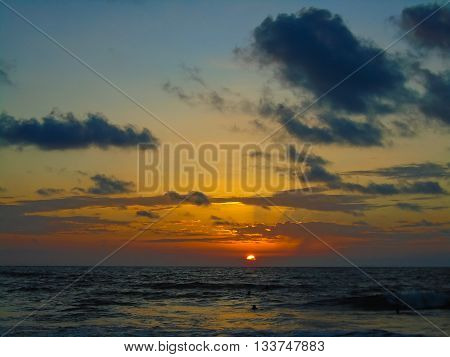 Sunset on the San Clemente beach in Ecuador