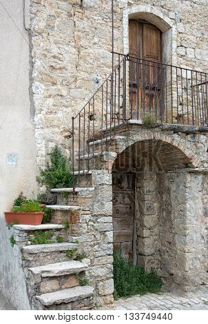 Picturesque Facade Of An Old Stone House