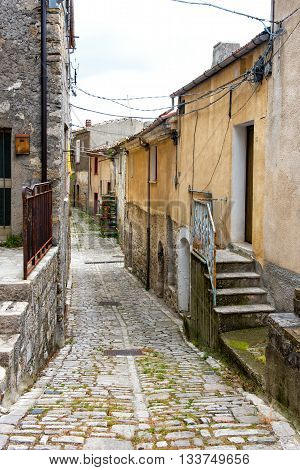 Old Narrow Cobbled Street In A Town