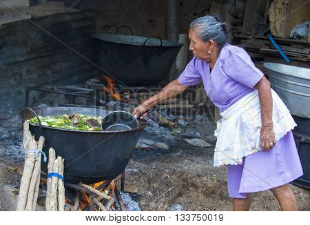 PANCHIMALCO EL SALVADOR - MAY 08 : A Salvadoran woman cooks during the Flower & Palm Festival in Panchimalco El Salvador on May 08 2016