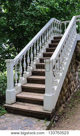 White staircase with banister in summer park