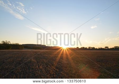 Sunrise and summer fields under blue sky natural background