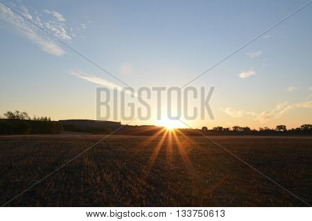Sunrise and summer field natural sunny background