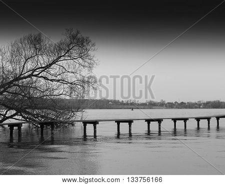 Horizontal bright black and white bridge on river background backdrop