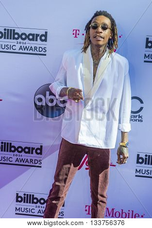 LAS VEGAS - MAY 22 : Recording artist Wiz Khalifa attends the 2016 Billboard Music Awards at T-Mobile Arena on May 22 2016 in Las Vegas Nevada.