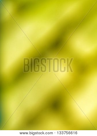 Abstract blurry pattern of diagonal green yellow bricks and dark fugues.