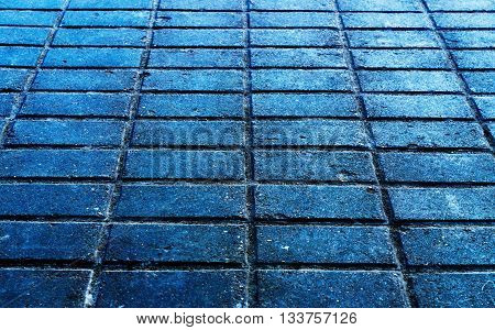 Horizontal blueish street brick texture background backdrop