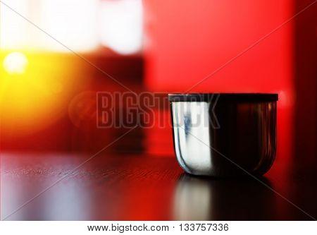 Horizontal cup of hot tea bokeh background