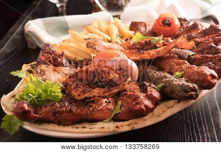 Mixed Grilled meat and vegetables close up view