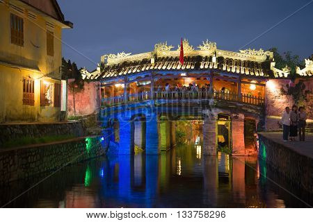 HOI AN, VIETNAM - JANUARY 02, 2016: Old Japanese bridge in the night lights. Historical landmark of the city Hoi An, Vietnam