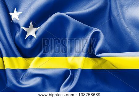 Curacao flag texture creased and crumpled up with light and shadows