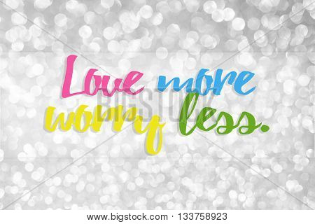 LOVE MORE WORRY LESS on bokeh abstract background