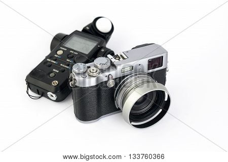 light meter and camera device on a white background