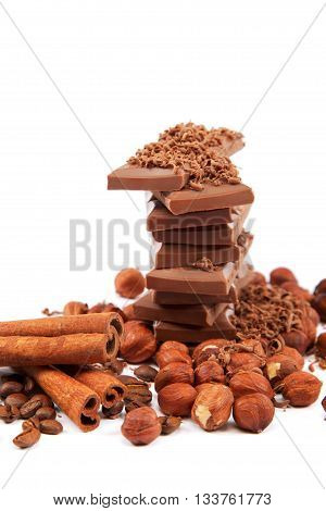 Chocolate and nuts isolated on white background.