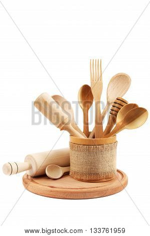 Wooden kitchen utensils isolated on a white background.
