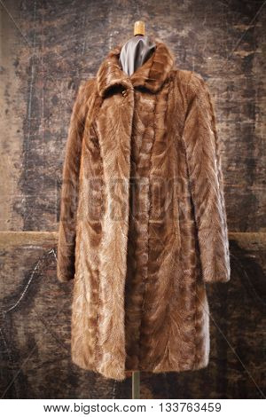 Long mink coat on a mannequin .