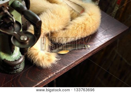 Clothing, leather with fox and leather sewing machine.