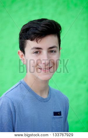 Portrait of a teenager rebellious man with a green background