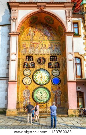 People in front of astronomical clock in Olomouc, Czech Republic. HDR image